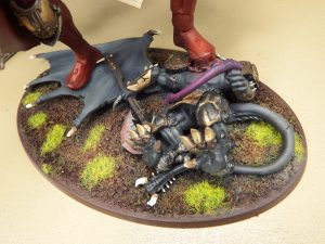 This custom Sisters of Battle Knight Titan is crushing a fallen daemon prince under its heel.
